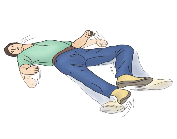 바닥에 누워 발작을 일으키구 있는 남성